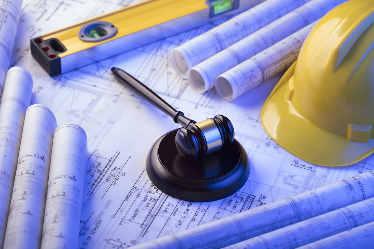 construction site and gavel for construction law at BF law